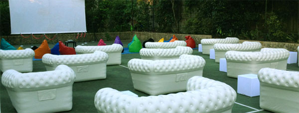 Chesterfield Inflatable Sofas on Tennis Court for Movie Night